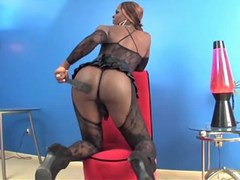 Big ebony tranny in stockings poses